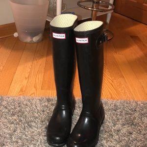 Black, tall Hunter boots